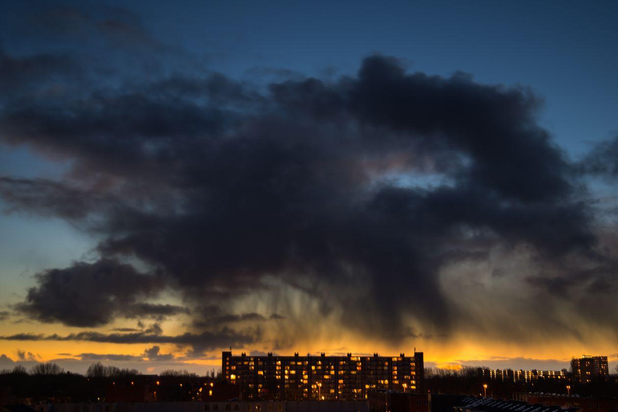 "Free photo ""Rain cloud above flat"""