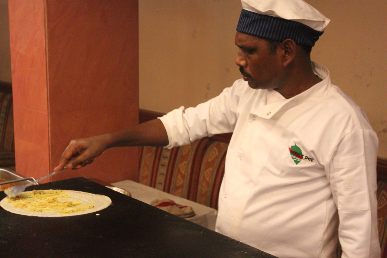 "Free photo ""Indian Chef Making Dosa"""