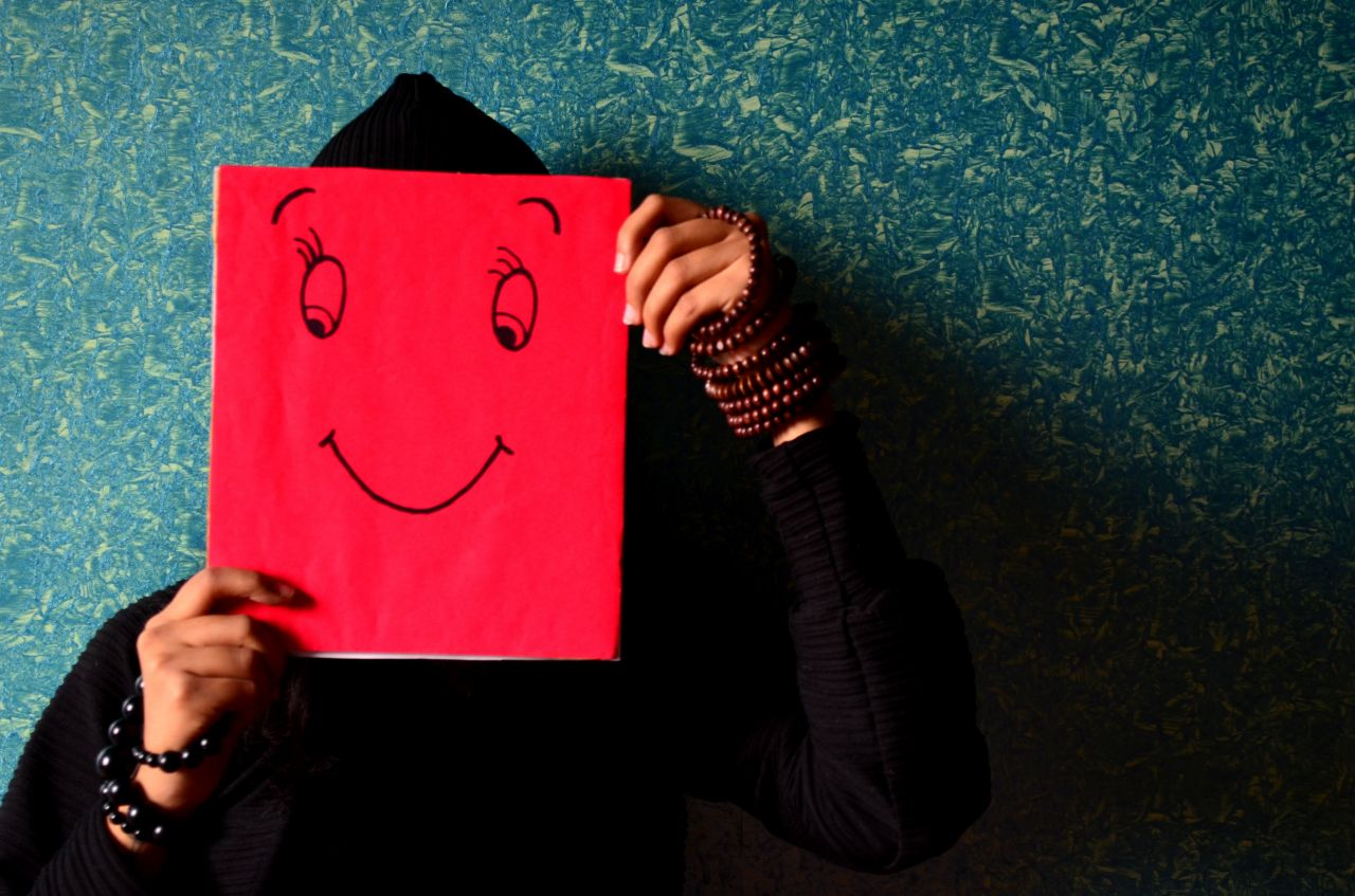 """Free photo """"Smiley Man Holding Card"""""""