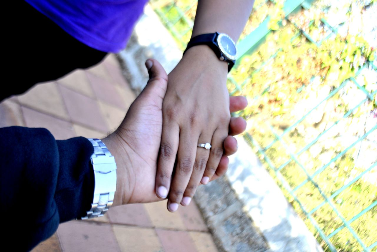 "Free photo ""Couple Holding Hands"""