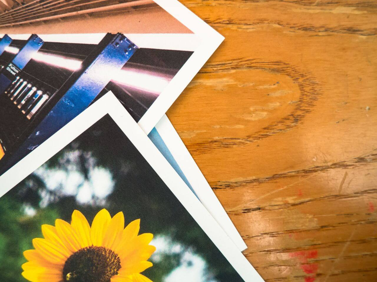 """Free photo """"Stack Photos Polaroid Wood Desk"""" by Jeffrey Betts (MMT)"""