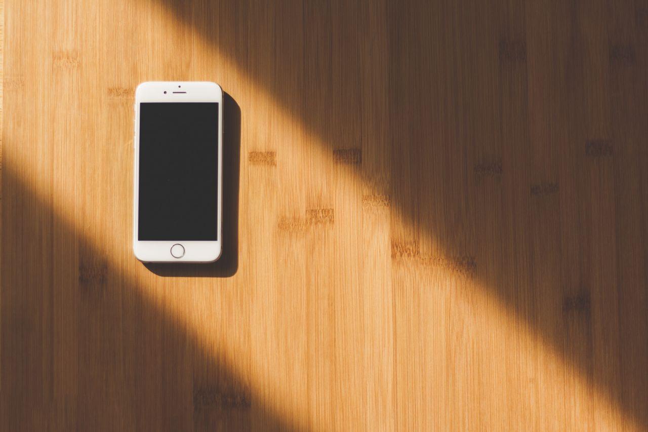 "Free photo ""Minimal White iPhone Desk"" by NegativeSpace"