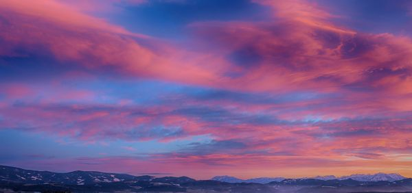 Winter Sunset over Mountains photo