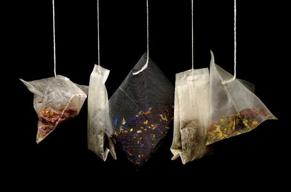Tea bags on a black background photo
