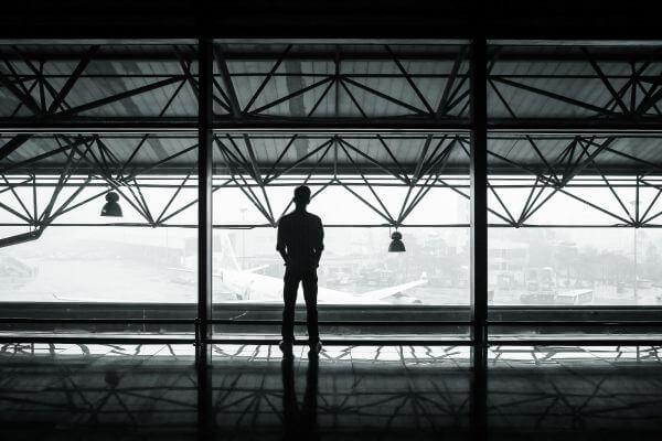 – Airport Plane Hanger Man Standing Back Foggy Mist Architecture