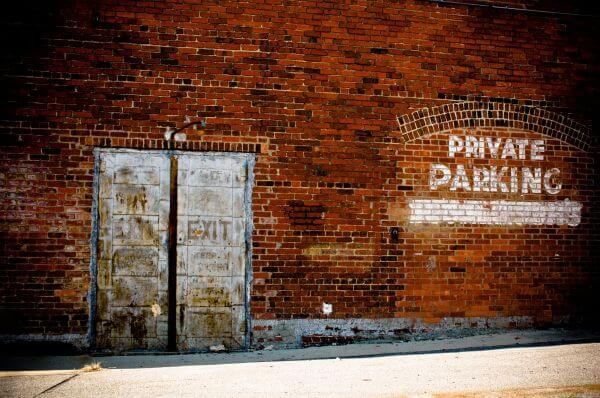 Brick Wall Rustic Old Metal Doors Private Parking photo