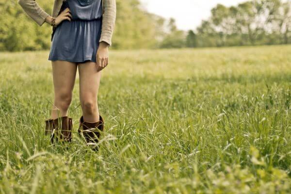 Girl Boots Standing Green Grass Field photo