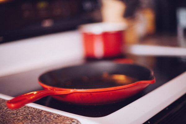 Red Skillet Frying Pan Stove Top photo
