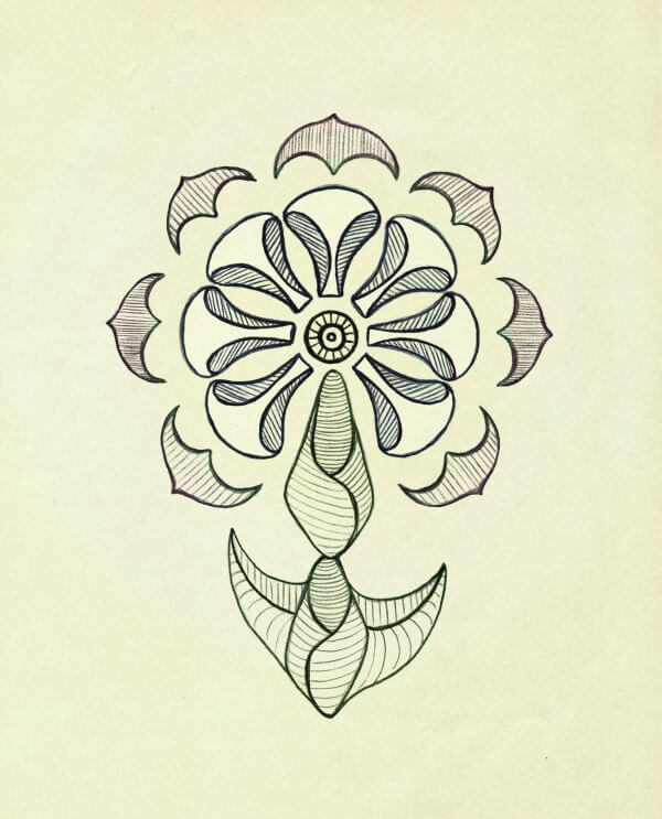 Symmetrical flower on yellow paper. Retro styling. Freehand drawing. photo