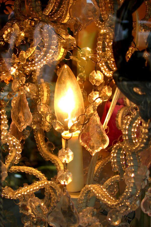 chandelier closeup with candle-flame bulb photo