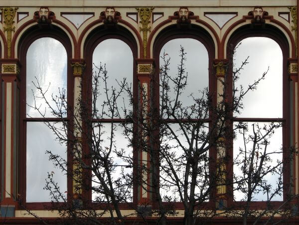 arched windows with tree photo