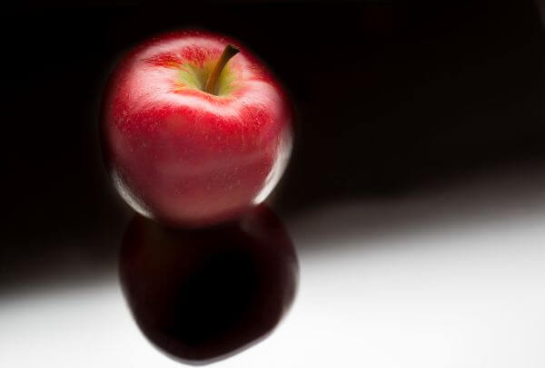 Shiny apple on black background photo
