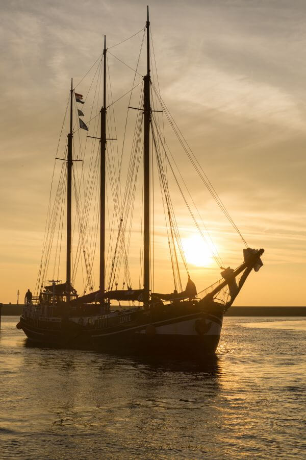 Sail boat at sunset photo