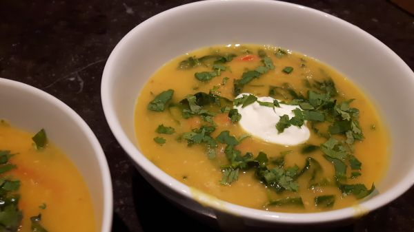 Indian lentil-pumpkinsoup with spinach photo