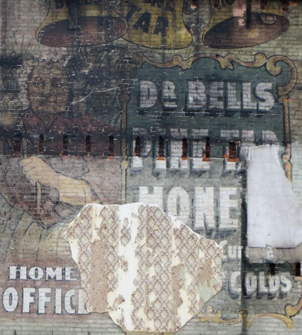 wall with old sign photo