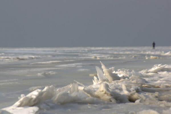 Man on drifting ice at Noordpolderzijl photo