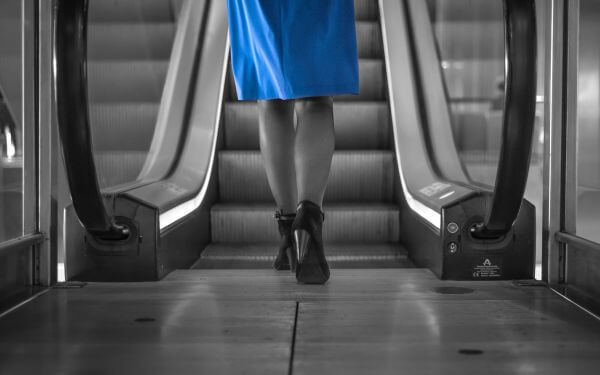 Woman approaching escalator photo
