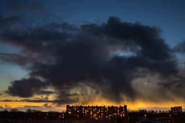 Rain cloud above flat photo