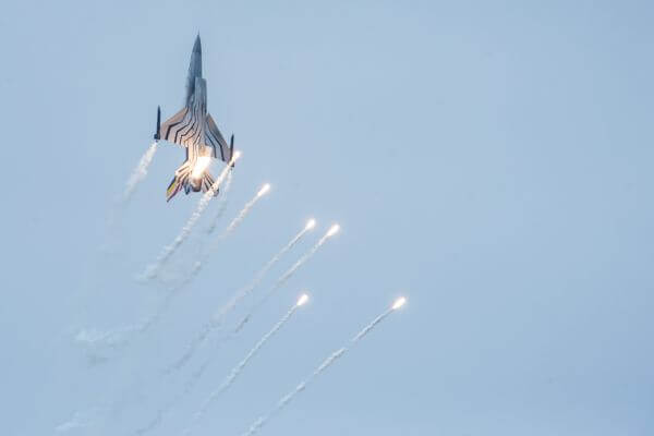 Jet fighter with flares photo