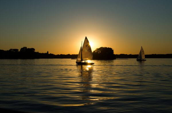 Sailing boats at sunset photo