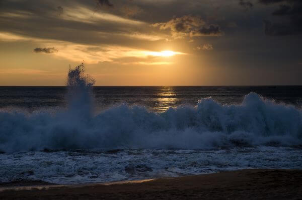 Waves at sunset photo