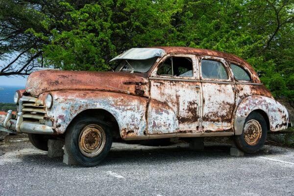 Rusty car wreck photo