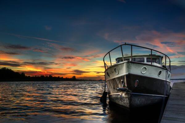 Boat at sunset photo