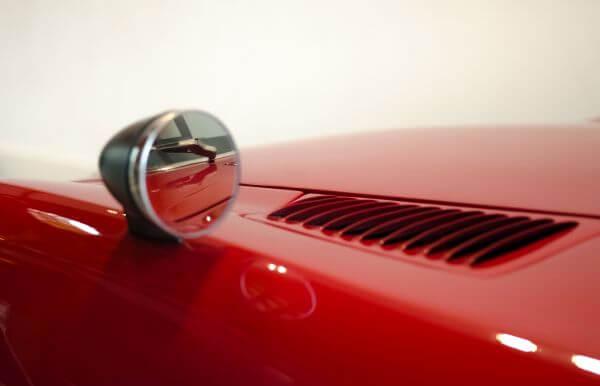 Red car mirror photo
