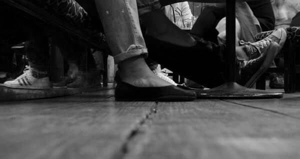 Feet in a bar photo