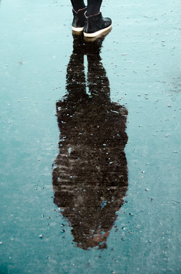 Woman reflected in water photo
