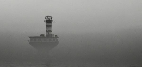 Lighthouse in the mist photo