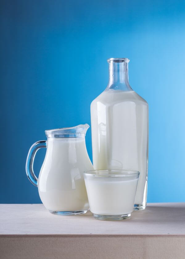 Milk Against Blue Background photo