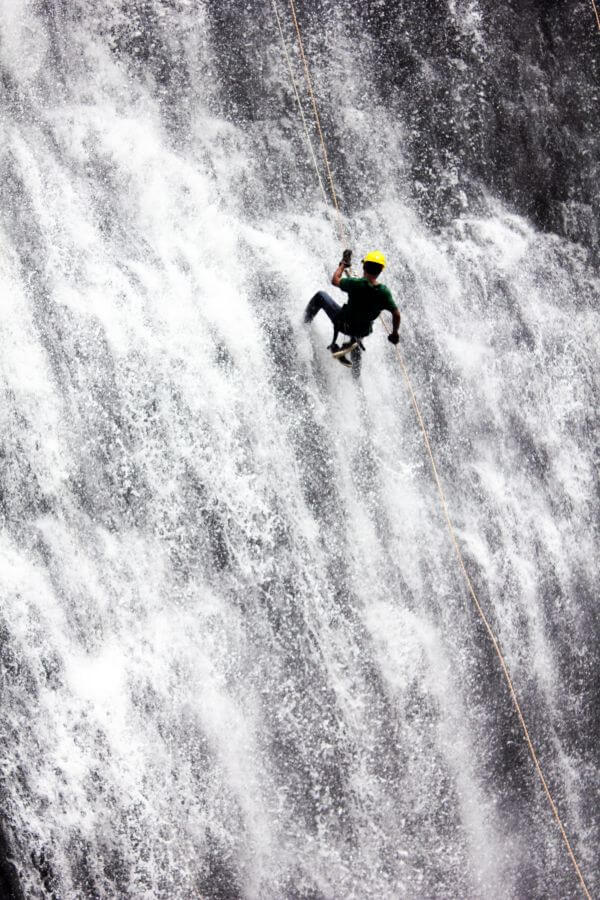 Man Adventure Waterfall Rappelling photo