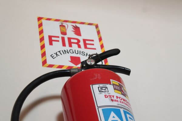 Fire Red Colored Cylinder Extinguisher photo