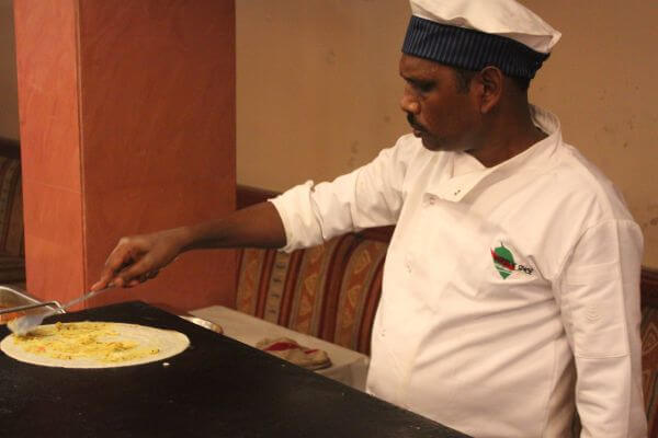 Indian Chef Making Dosa photo