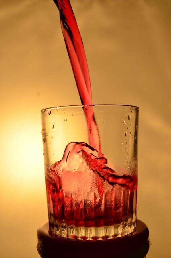 Red Liquid Falling Glass photo