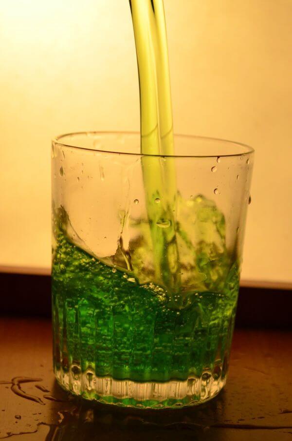 Glass Of Greenish Liquid photo