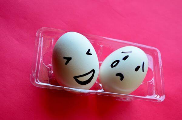 Happy Sad Smiley On Egg photo