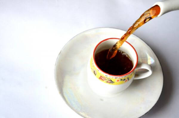 Tea Cup Pouring photo