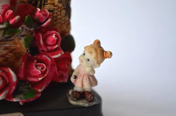 Little Girl Statue Roses photo