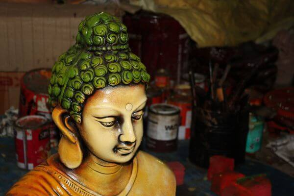 Buddha Idol With Workshop Background photo