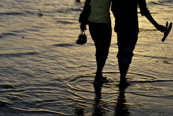 Couple Walking Waves photo