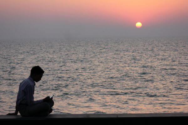 Man Using Mobile Sunset photo