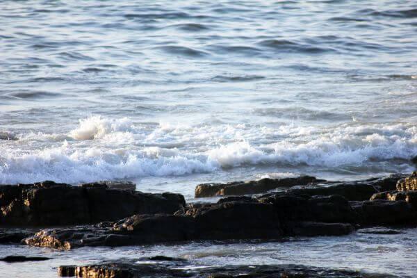 Sea Waves Crashing On Rocks photo