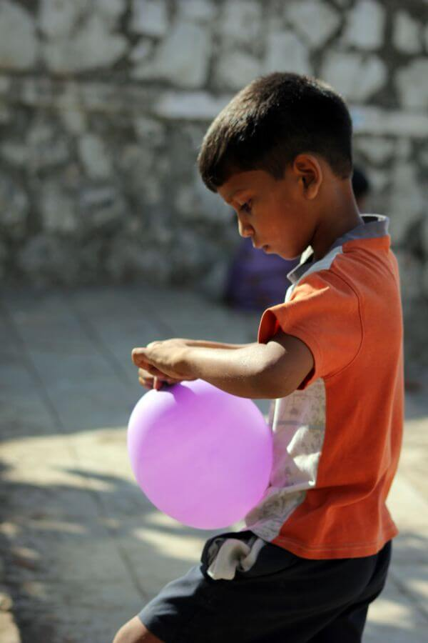 Boy Blowing Balloons photo