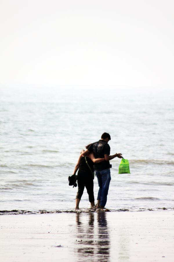 Couple Walking Beach photo