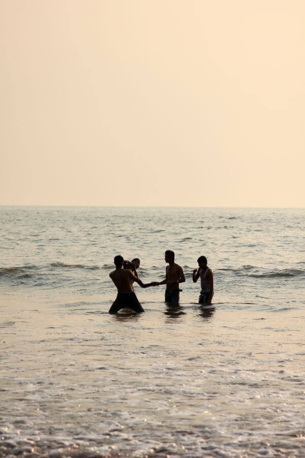 Friends Playing In Sea Beach photo