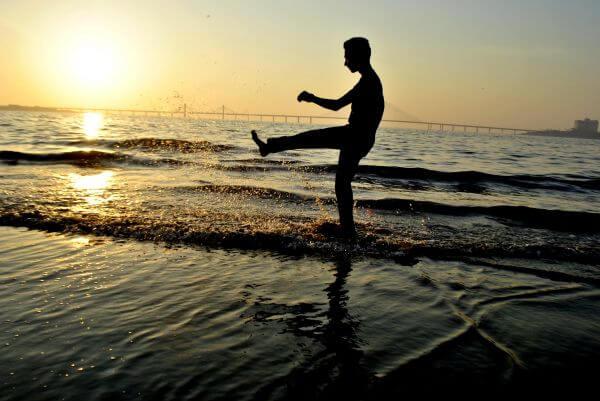 Man Kicking Water Play photo
