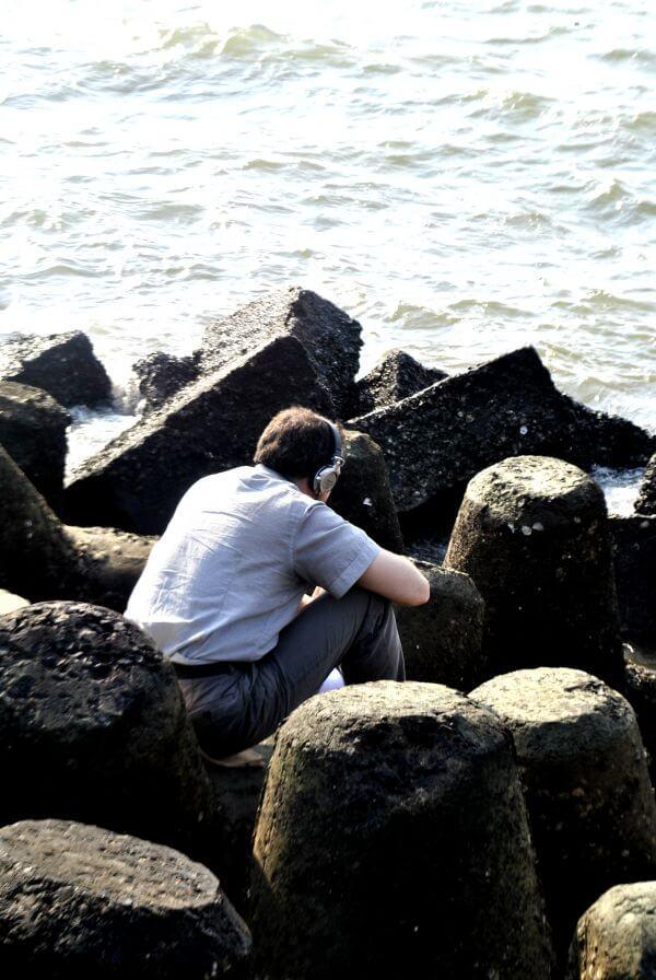 Man Headphones Sitting photo