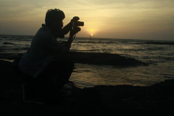 Photographer Shooting Sunset Sea photo